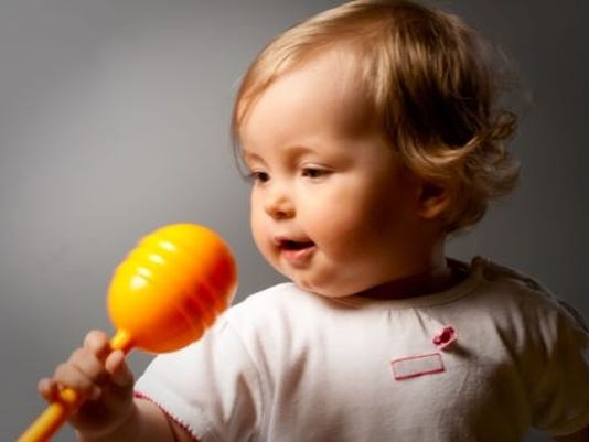 Baby with shaker