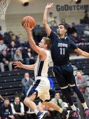 Lebanon Valley's Sam Light drives to the basket during
