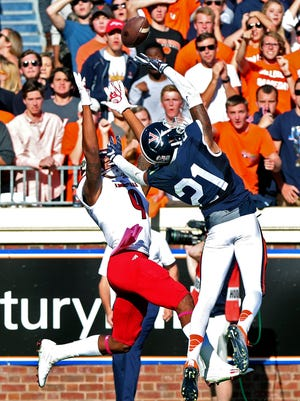 Louisville wide receiver Jaylen Smith (9) catches a touchdown pass over Virginia free safety Juan Thornhill (21) during the second half of an NCAA college football game on Saturday, Oct. 29, 2016 in Charlottesville, Va. Louisville defeated Virginia 32-25. (AP Photo/Ryan M. Kelly)