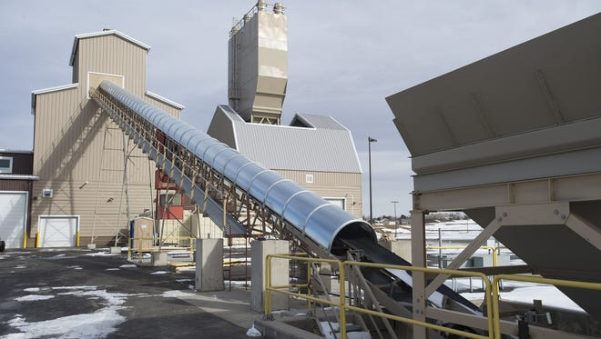 Transport belts head into a Ready-Mix concrete facility at the new Martin Marietta asphalt plant near Johnstown.