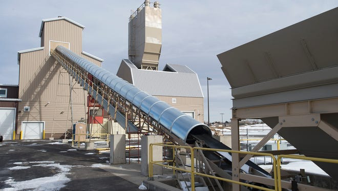 Transport belts head into a ready-mix plant at the Martin Marietta asphalt-and-concrete distribution center off Weld County 13.