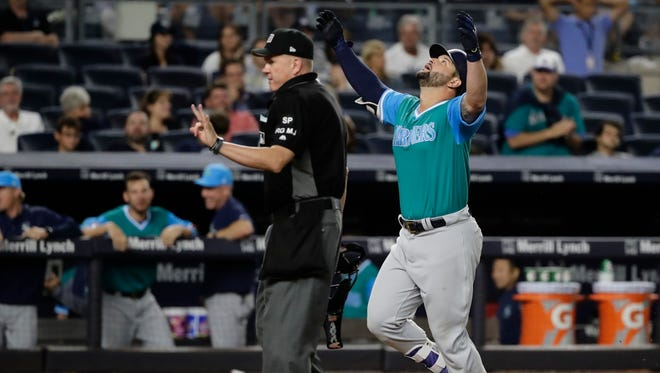 Yonder Alonso celebrates his 11th-inning home run, which gave the Mariners a 2-1 win over the Yankees on Friday in New York.