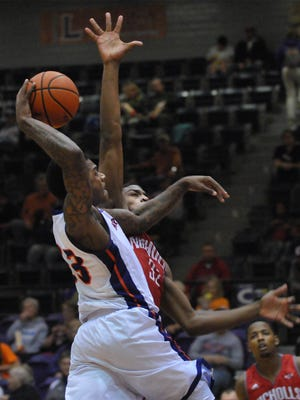 NSU's Zeek Woodley scored 34 points in a Southland Conference tournament win against McNeese State.