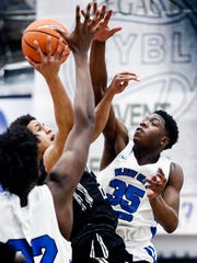 Bluff City Legends forward Malcolm Dandridge (right) defends the shot of NY Lightning forward Fredelien Castro Delacruz (left) during their Nike EYBL game in Dallas, Texas.