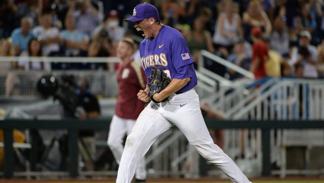 LSU Tigers pitcher Zack Hess (38) reacts after defeating the Florida State Seminoles at TD Ameritrade Park Omaha.
