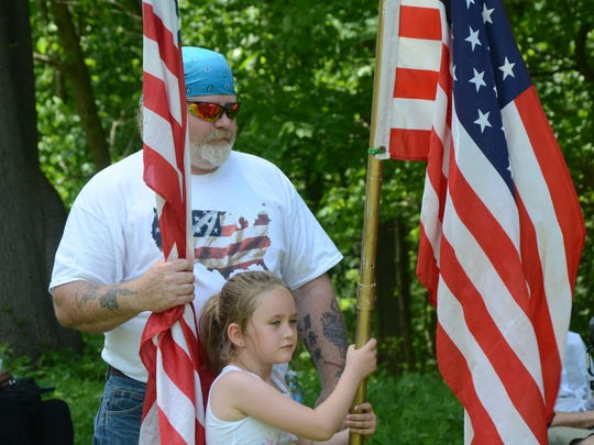 Tim Scroggins and his daughter, Maresa, 5, were part of the honor guard at Fort Custer National Cemetery.