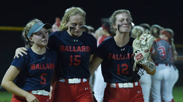 Ballard seniors, from left, Isabell Hobbs, Maggie Larson and Isabella Johnson, react after losing a 6-5 heartbreaker to No. 8 Dallas Center-Grimes in the Class 4A regional final on Tuesday in Dallas Center. The Bomber seniors made the regional finals three times in four years and were part of the 2017 team that placed second at state in 4A. Photo by Nirmalendu Majumdar/Ames Tribune