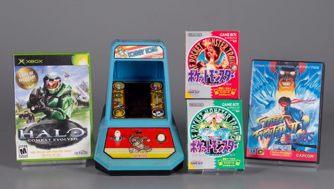 """This undated photo provided by The Strong shows the four inductees for the 2017 class of the World Video Game Hall of Fame. From left to right are: ''Halo: Combat Evolved,"""" """"Donkey Kong,"""" """"Pokemon Red and Green,"""" and ''Street Fighter II."""" (Bethany Mosher/The Strong via AP)"""