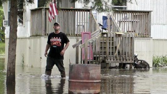 James Brown exits his home in the 7000 block of Maple Bend Court in the White County town of Buffalo, Thursday, June 18, 2015, after floodwaters turned his property into an island. (Photo: