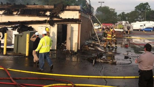Firefighters from Milford and South Lyon continue to mop up the fire that destoryed Holden's Party Store on Milford Road Wednesday morning.