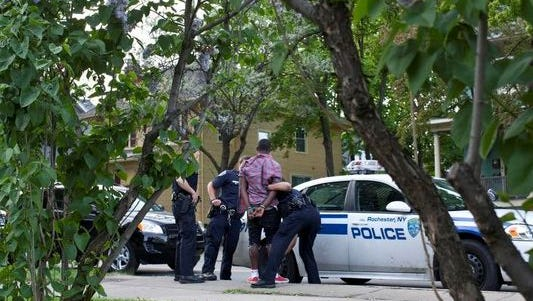 File photo of police apprehending a young man after a fight erupted on South Avenue in 2013 at the Lilac Festival.