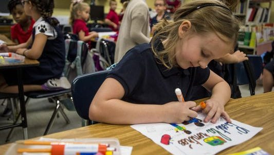 A Lafayette Parish elementary student works on an art project in class.