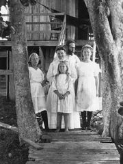 Dr. Charles and Dr. Mary Olds with their children (from left) Rosalie, Saloma and Orida.