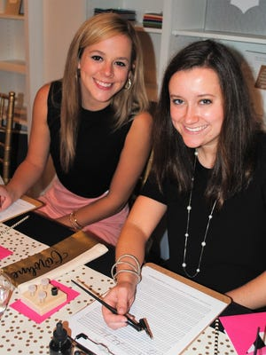 """Demoiselle Deb Avery Givens, Caroline Bowman take a calligraphy lesson at """"Perfectly Polished!"""""""