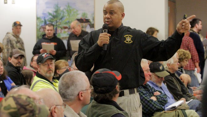 Chemung County Sheriff Christopher Moss speaks Jan. 29, 2013, at a meeting about state firearms legislation at Big Flats Community Center.
