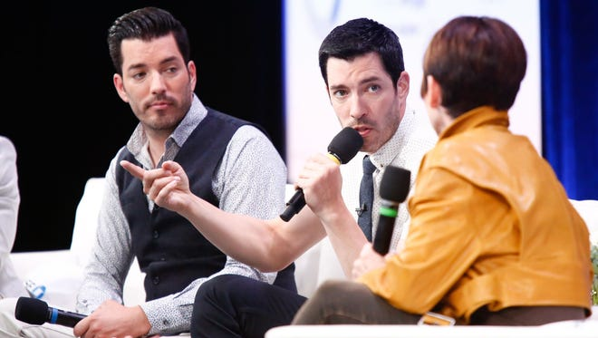 HGTV's Property Brothers, Jonathan Scott, left, and Drew Scott talk about mortgage financing and home remodeling during a news conference July 14, 2017, at Google in New York City.