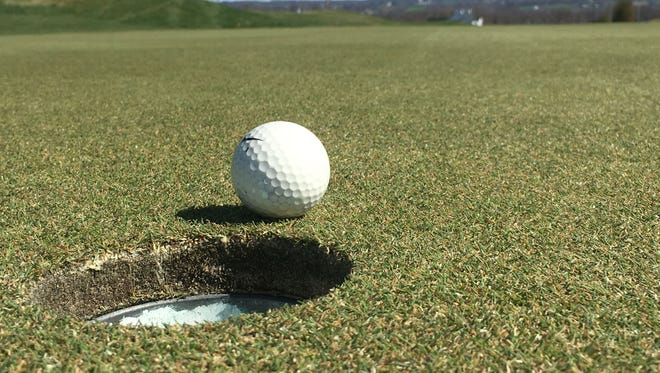 A ball rests near the hole on the par-4 5th green Tuesday at Royal Manchester Golf Links. Jesse Hartman, course superintendent and Northeastern High School graduate, played a big part in the course's greens recovering from extensive damage a year ago.