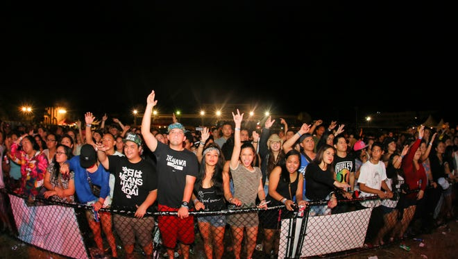 Fans dnjoy the first annual Trench Fest show at the Guam Greyhound Park on Jan. 16, 2015.
