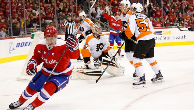 Dmitry Orlov, left, and the Capitals handed the Flyers their second consecutive loss.
