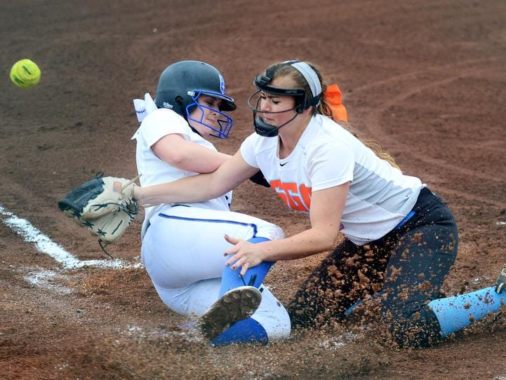 A CAK baserunner slides home in front of South Gibson pitcher Kaitlyn Martin in Thursday's Class AA state tournament softball game.