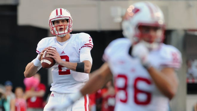 Wisconsin Badgers quarterback Joel Stave (2) rolls out on the final drive of the game against the Nebraska Cornhuskers at Memorial Stadium. Wisconsin defeated Nebraska 23-21.