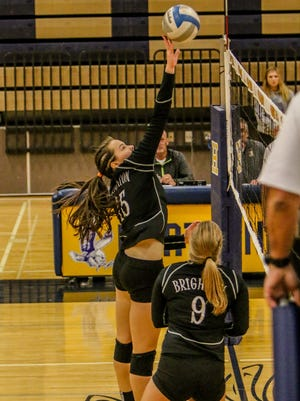 Brighton's Lindsay Hillstrom tips the ball at the net in the district championship victory over South Lyon.