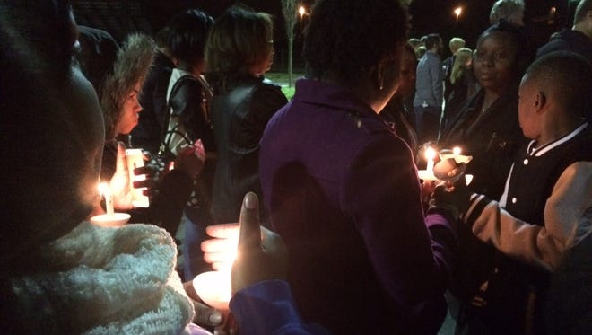 People gather for a vigil for the three Franklin teens killed in a car crash last week.
