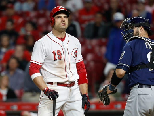 Joey Votto of the Reds reacts as he heads back to the