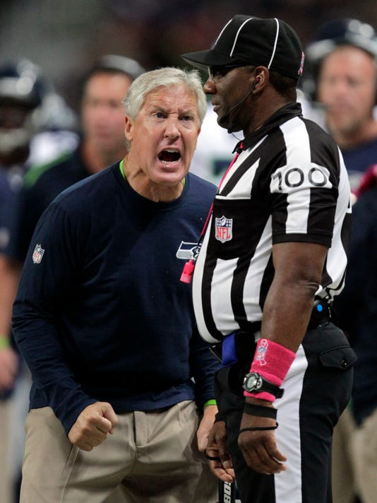 Seattle Seahawks head coach Pete Carroll, left, yells in the direction of line judge Tom Symonette during the fourth quarter of an NFL football game against the St. Louis Rams, Sunday, Oct. 19, 2014, in St. Louis. (AP Photo/Tom Gannam)