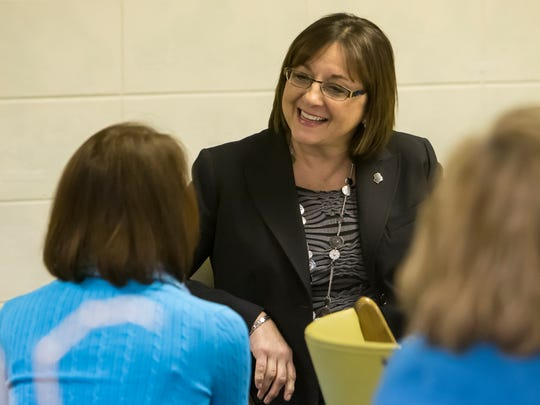 Wisconsin's first lady Tonette Walker visits with women during a discussion of female leadership.