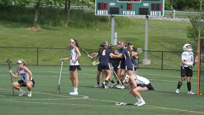 Skaneateles celebrates after defeating Bronxville 11-10 in overtime in a New York State girls lacrosse Class C state semifinal game at Tompkins Cortland Community College in Dryden on Friday, June 10th, 2016.