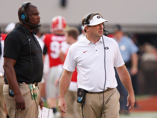 Georgia defensive coordinator Mel Tucker, left, and  coach Kirby Smart watch from the sideline during the first half of an NCAA college football game against South Carolina on Saturday, Nov. 4, 2017, in Athens, Ga. (Joshua L. Jones/Athens Banner-Herald via AP)