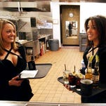 In this Feb. 17, 2005 file photo, Borgata cocktail servers Megan Mercado, left, and Sara Jamison fill orders for customers at the Borgata Hotel Casino & Spa in Atlantic City, N.J. On Sept. 17, an appeals panel upheld the Borgata casino's policy of regulating how much its cocktail waitresses can weigh. The court said the casino's personal appearance standards are lawful, but it also said part of a lawsuit brought by 21 servers should be returned to a lower court to determine if the women were subjected to a hostile work environment regarding how casino managers enforced those standards.