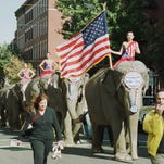 "In this file photo, a procession of Ringling Bros., Barnum and Bailey Circus elephants parade through Boston's North End neighborhood on their way to a ""Patriotic Pachyderm Pasta Party."" The circus will phase out the show's iconic elephants from its performances by 2018."