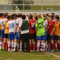 East Rockingham and Robert E. Lee High School come together before the match to dedicate the game of Ethan Zander. Robert E. Lee High School players wore red and black bands to commemorate Zander.