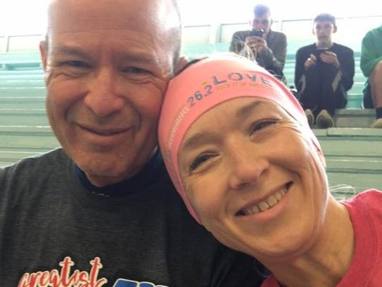 Rebecca Shawhan had already finished the 5K race when she found out her husband, Tim, had dropped to the pavement.