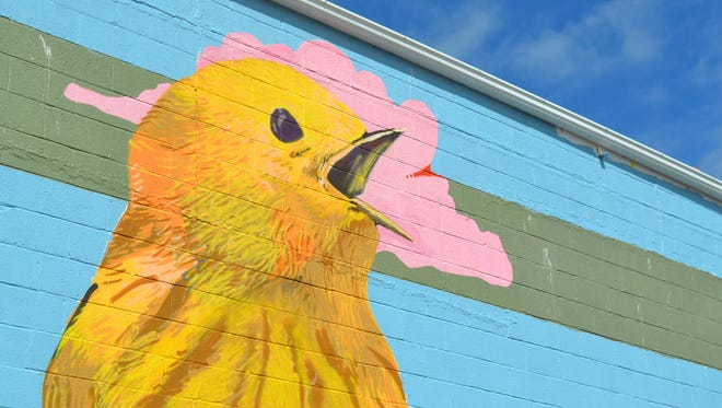This mural of a yellow warbler, commissioned by John Madison, was created by local artist Matt Ritter with help from the Greater Port Clinton Area Arts Council.