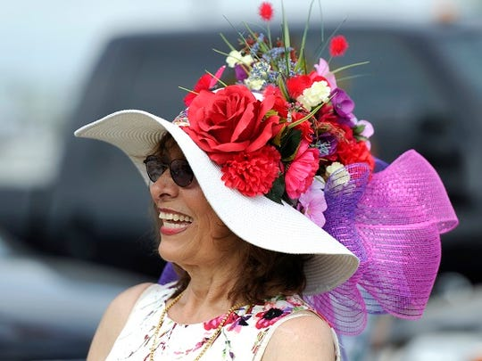 Millie Rivas wears a hat that she made from flowers