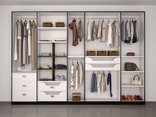 wide closet with a large window,