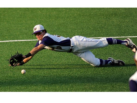 Wylie shortstop Zach Smith (39) dives for a ball in