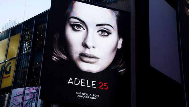 A billboard for Adele's new album, '25' in New York's Times Square this month. The British singer's third album is already the top-selling of the year.