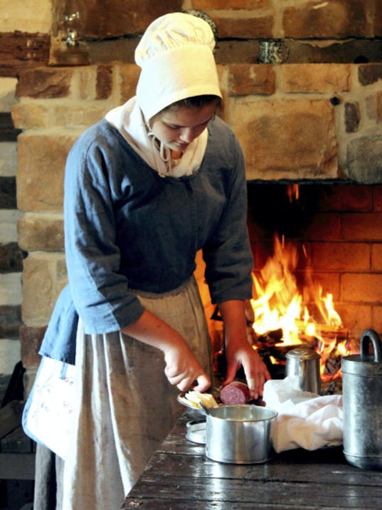 Linda Zeigler demonstrates colonial hearth cooking at the 2014 Colonial Day at the State Historic site of Fort Loudoun.