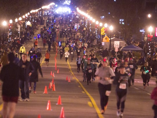 Runners fill Grand River Ave. in downtown Howell Friday,