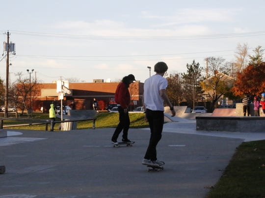 Skateboarders at Ithaca Skate Park off Wood Street