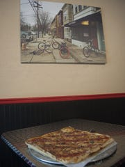 Angelo's specialized is in thin-crust, pan pizza, but also offers hoagies, cheesesteaks and other specialties.