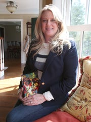 "Janine Crowley Haynes at her Chappaqua  home. She is the author of ""My Kind of Crazy: Living in a Bipolar World,"" about her illness, suicide attempt and recovery. ""It's all a blur,"" Haynes says of her lost memory of her illness. ""I wish I could give that to my son and my husband, because I don't remember a lot of it, to take that away for them."""