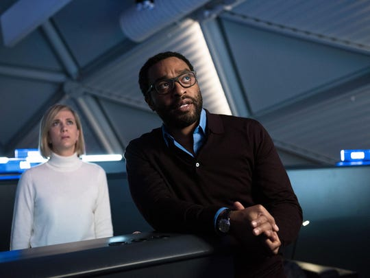 Kristin Wiig, left, and Chiwetel Ejiofor appear in