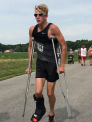 Princeton Community High School senior Justin Niederhaus unofficially broke the world record for the fastest 5K on crutches Saturday in the Haubstadt Laufenfest.