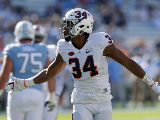 Virginia's Bryce Hall (34) reacts during the first