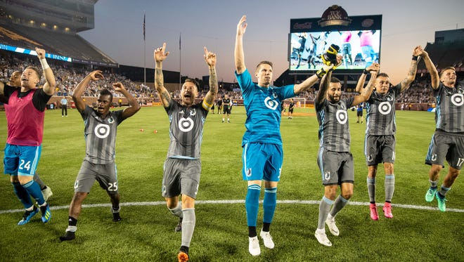 Minnesota United players celebrate a 2-0 win over the Montreal Impact at TCF Bank Stadium.